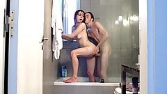 Amateur brunette takes his cock deep in the shower