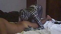 Spiderman superhero plays with his victim
