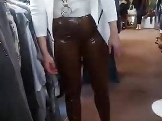Boutique de lingerie - Wife in brown latex pants in her boutique