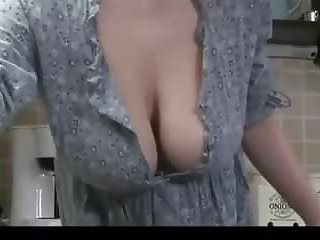 Tit falling out Her big boobs fall out while cleaning the kitchen