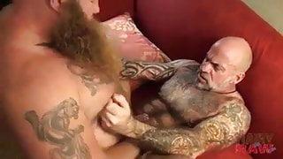 Viking and pierced tattoo dad