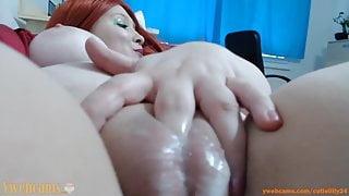 Busty redhead fingering pussy