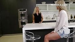 Blonde mature gives young guy a sneaky blowjob