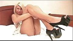 Blonde playng witch black high heels