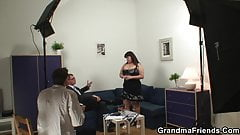 Busty granma swallows two cocks after photosession