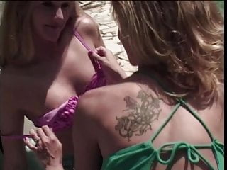 Blonde milf pool Blonde milfs play with strap-on and anal beads by the pool