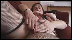 Busty mature brunette with hairy pussy strips and spreads