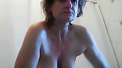 Mature girlfriend caught leaving shower and drying tits