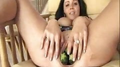 BUSTY TEEN HAS FUN WITH CUCUMBER  C5M