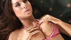 Hot brunette with nice boobs in bed masturbating at home