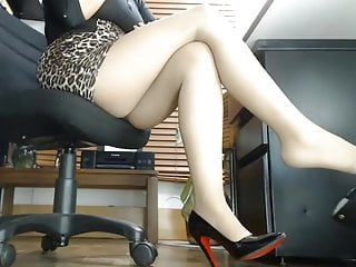 Men in pantyhose and heels Under the office desk. long legs in pantyhose and heels
