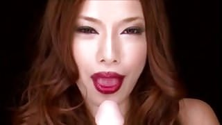 Japanese lipstick babe shows blowjob technique on fake cock