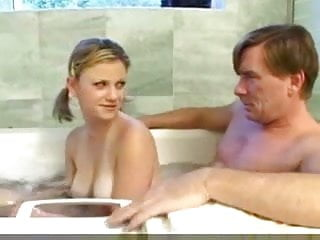 Teen girls in bathing Teen girl and daddy have fun in the bath