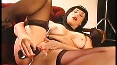 Shanna McCullough masturbates as Bettie Page