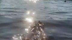 Heidi Klum floating in the water