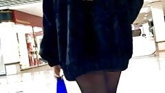 Candid Beauty Long Legs Walking in Skirt and Stocking