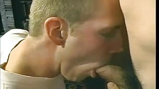 Sucking the cum out of two big dicks