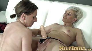 MILF Linda G sucks and rides matures Kathy White's strap-on