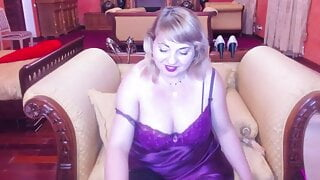 Hot mature russian lady with makeup applying lipstick
