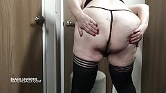 Sally strips down to her bra and black satin panties