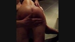 Spanking the red buttocks of my slave
