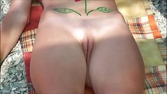 Girls and milfs on the beach with shaved pussies