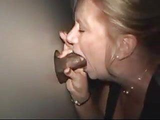 Sexy woman breastfeeding man - Sexy woman at the gloryhole