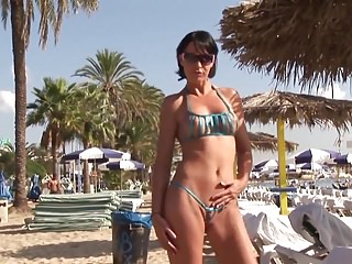 Sexy bikini sights Hot brunette milf posing in sexy bikini on public beach