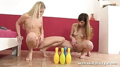 Lesbians knock down bowling pins with their piss - PureSexM