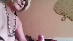 Big breasted granny jerks off a guy