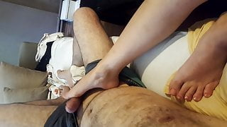 Wife gives footjob long big size feet toes,whlie watching tv