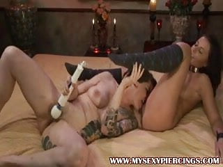 Licks sex toy - Tattooed and pierced lesbians with hitachi vibrator licking