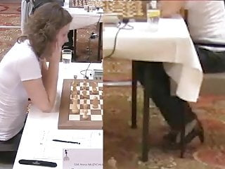 Amateur chess games database - Chess girl syntribates during game