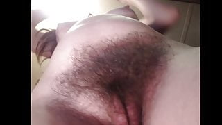 StepMom with saggy tits plays with her hairy bush