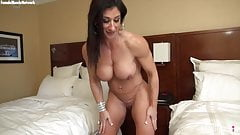 Muscular female bodybuilder shows her big tits and big clit