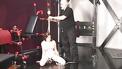 Hard rope play and boot licking turn on this sexy young brunette in corset