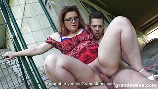 Horny mature teacher catches a young guy and fucks him