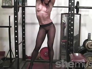 Hot photo porn star woman Fit muscular porn star poses in the gym wearing pantyhose