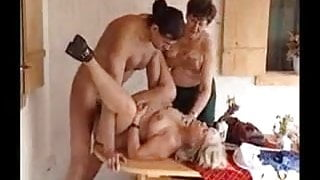 TWO GRANNIES GETS FUCKED OUTDOOR ON A TABLE