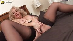 Blonde mature slut getting wet on couch