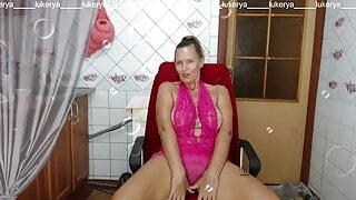 Lukerya in pink drinks coffee on the washing machine