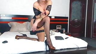 Gorgeous MILF in fishnet stockings and platform heels