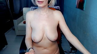 Slim woman shows her naked mature body