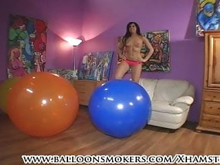 Sexy girls popping balloons Teen jumps on big balloons to pop