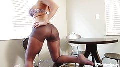 Blonde in pantyhose displays her sexy soles