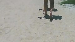 Two nice asses walking out the beach
