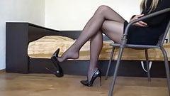 Pantyhose and heels dangle
