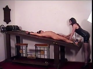 Thousand foot krutch rack fist Hottie in latex, mistress ava, fooling with her slave on the rack