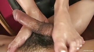 Yui loves using her oil and her feet to make this guy cum ha