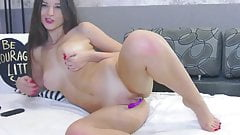 Beautiful Cam model teases with oil and toy
